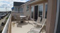 03_Front_Deck_with_Table_and_Chairs